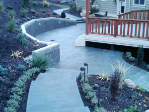Concrete retaining walls for hillside homes, stamped concrete patio, Bellingham WA