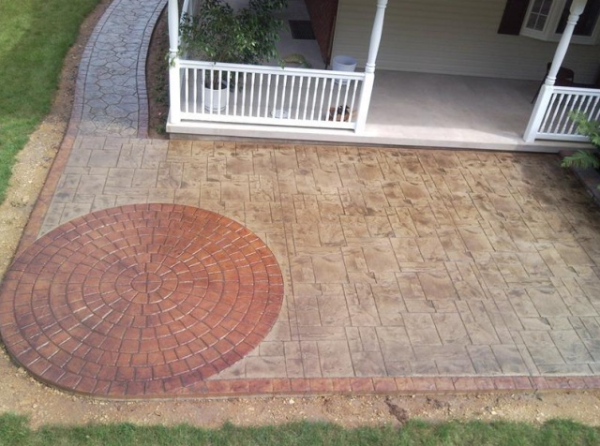 Decorative patio spaces - stamped and stained concrete