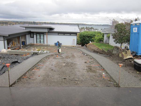 Aggregate bands on decorative concrete driveway