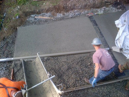 The process of pouring and leveling pervious concrete