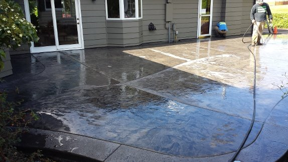 New Feature Project Concrete Patio Replaces Wood Decking