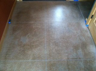 Finished--concrete_floor_colored_and_cut_to_look_like_tile.jpg