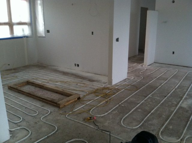 General_contractor_on_the_job_laid_the_water_tubes--these_are_what_heats_the_concrete-1.jpg