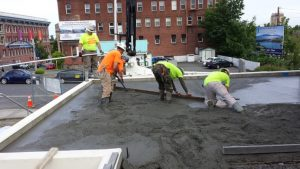 Custom Concrete Contracting team members finish the concrete flatwork at the new Community Food Co-Op in Bellingham.