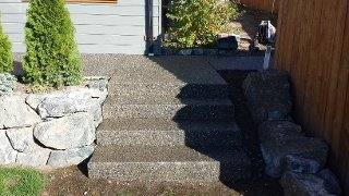Aggregate concrete patio increases usability of garden area
