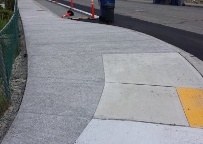 Pervious concrete sidewalk with ADA ramp insert