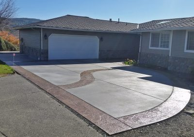 Concrete driveway with decorative bands
