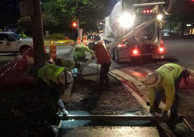 Installing concrete sidewalks at night in Everett, WA