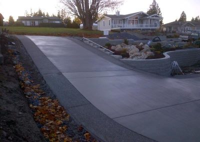 Broom finished concrete driveway with aggregate bands