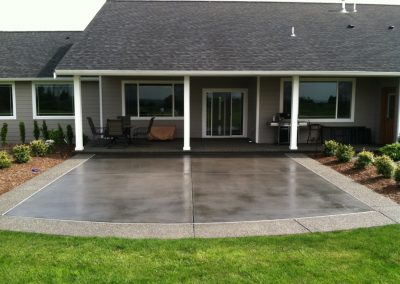 Stained patio with aggregate border