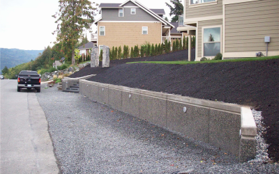 Cast concrete vs. stacked stone retaining walls