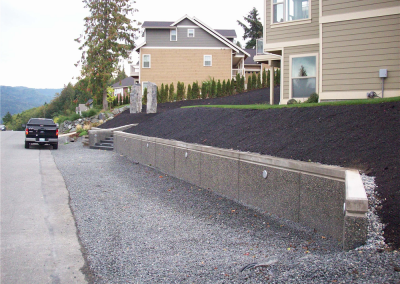 Exposed aggregate retaining wall w/lighting