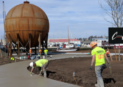 Concrete path leading to acid ball art on Bellingham waterfront