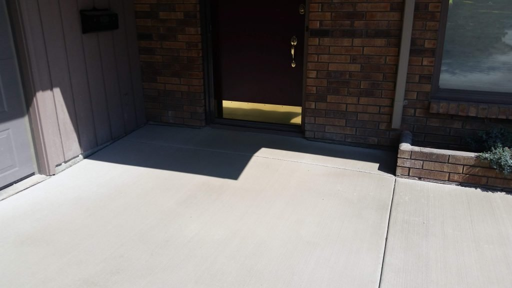 Smoothly graded and expertly sloped concrete allows for step-free entrance to the home.