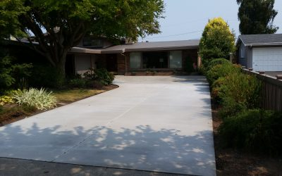 Project feature: Broom-finished replacement driveway tucks beautifully into existing space