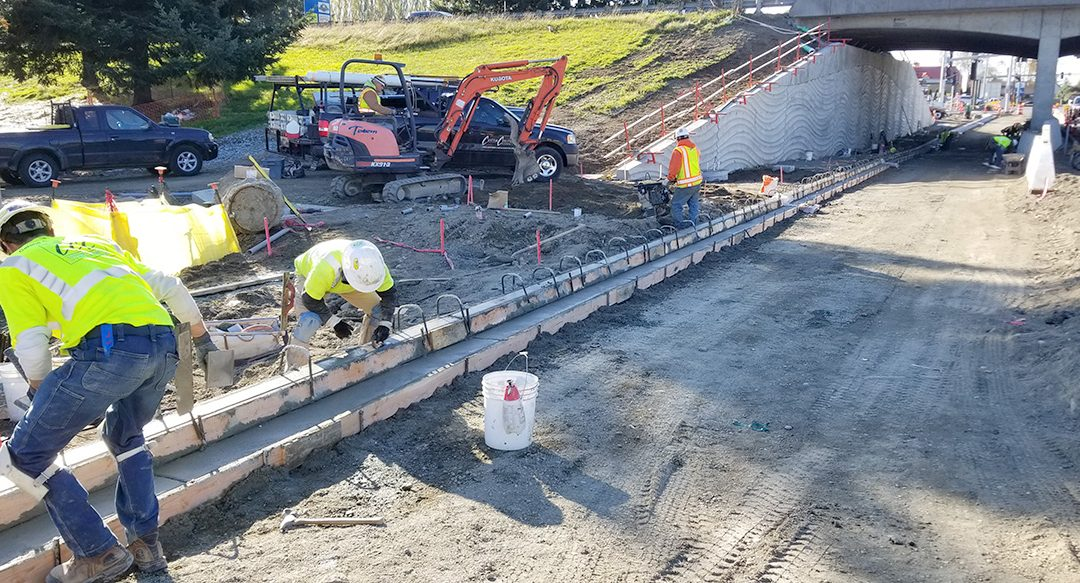 Custom Concrete crews pouring concrete as part of the College Way widening project in 2020.