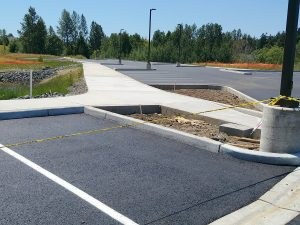 Concrete sidewalks and curbs in new parking lot
