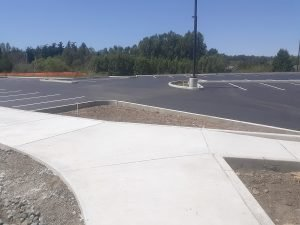 Concrete sidewalk in new parking lot