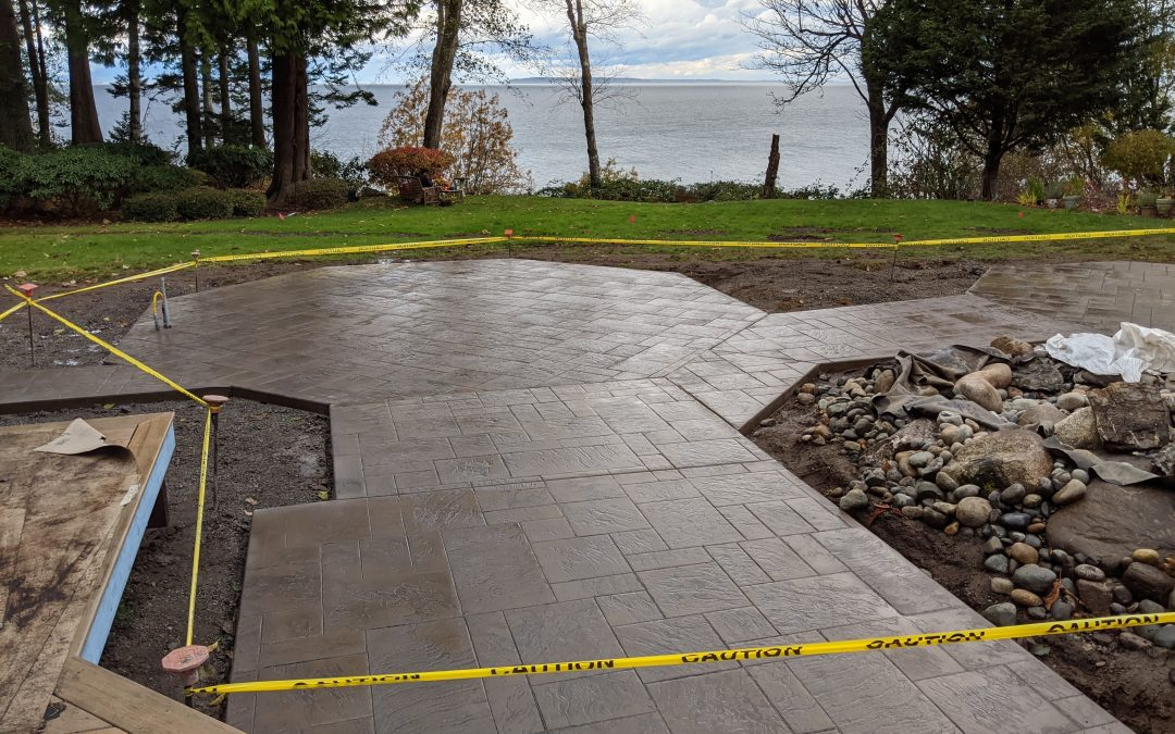 Stamped concrete patio overlooking the water